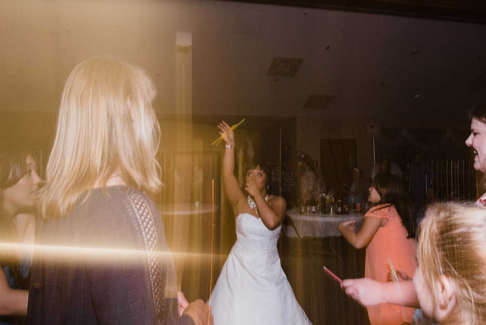 creative photo of bride dancing at Parker Evangelical Presbyterian Church