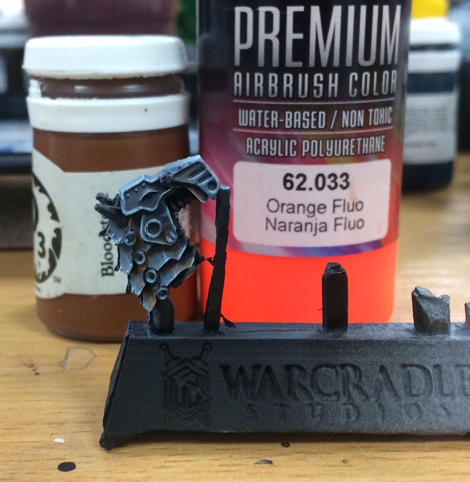 Finally, add a very fine glaze of colour to bring the NMM to life. You can do this in many different ways to achieve different types of metal. I've added a vague rusty feel by mixing Bloodstone and Fluro Orange in equal parts with around ten parts water which I've applied to recessed areas to add visual interest.