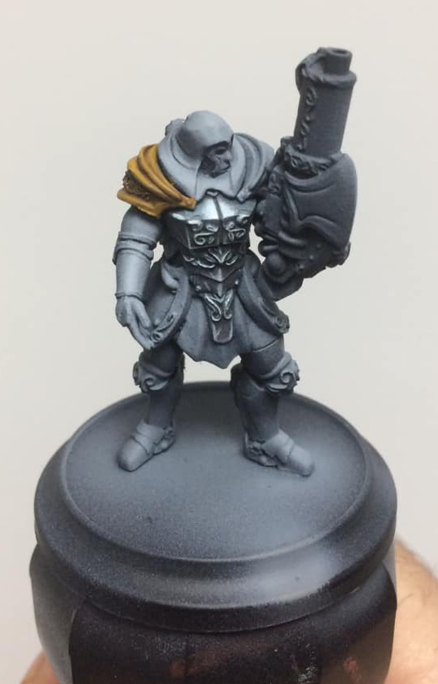 A wash of Brown Ink is applied across the whole shoulder pad to add separation and contrast - the key to fast NMM.