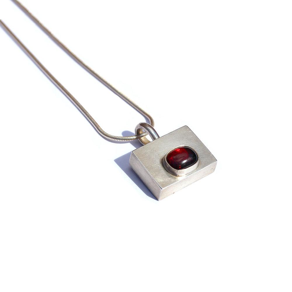 Silver cuboid pendant with garnet gemstone setting
