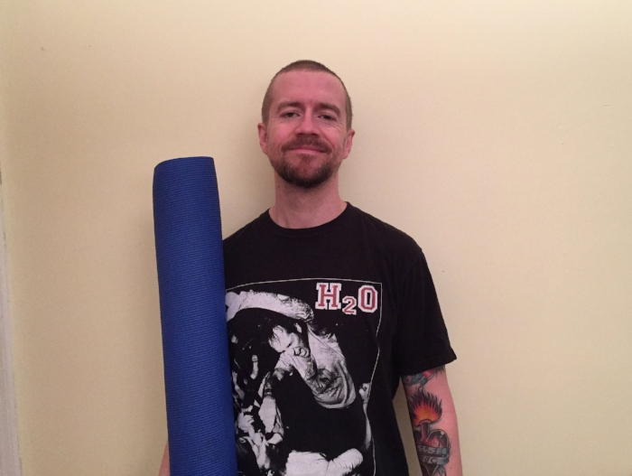 Author Michael Patrick and his trusted yoga mat.