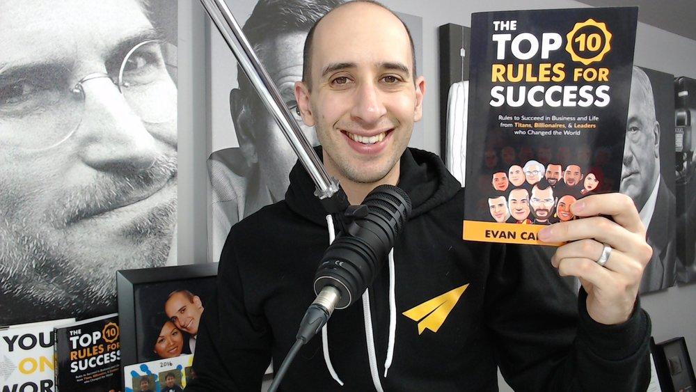 Evan holding Top 10 Rules book.jpg