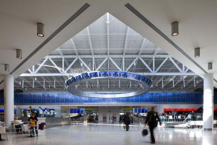 JFK JetBlue Terminal   Where architecture, choreography, and technology meet-- a custom, digitally programmed information yoke