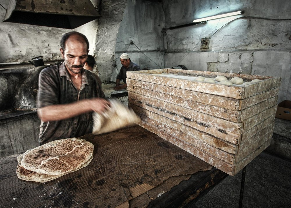 Hot and steamy fresh flat breads ready to be sold from the table (Damascus).