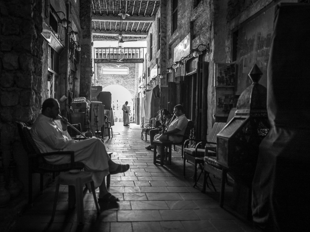 The Mosque Dodgers: Smoking shisha in the darkened alleys of Souk Waqif on a Friday morning.