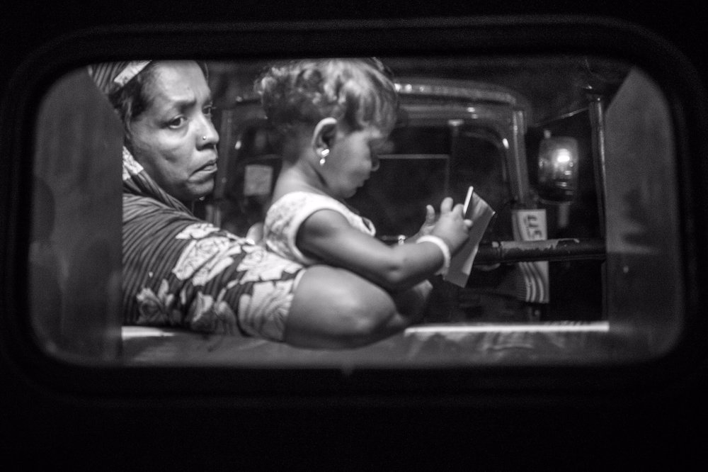 Where is he ... we wanna get home ... (Leica Q) Taken through the plastic back window of a tuc-tuc at night.