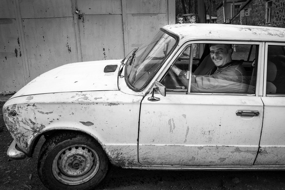 A Gergeti local in his Lada