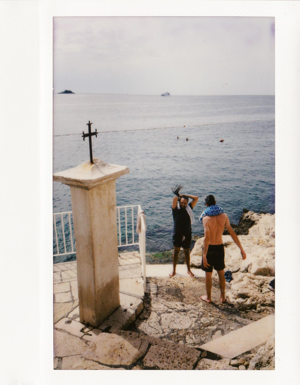 "Rovinj, Croatia. This is the only candid ""street"" shot I took of people, expecting the Instax to behave and not flash."