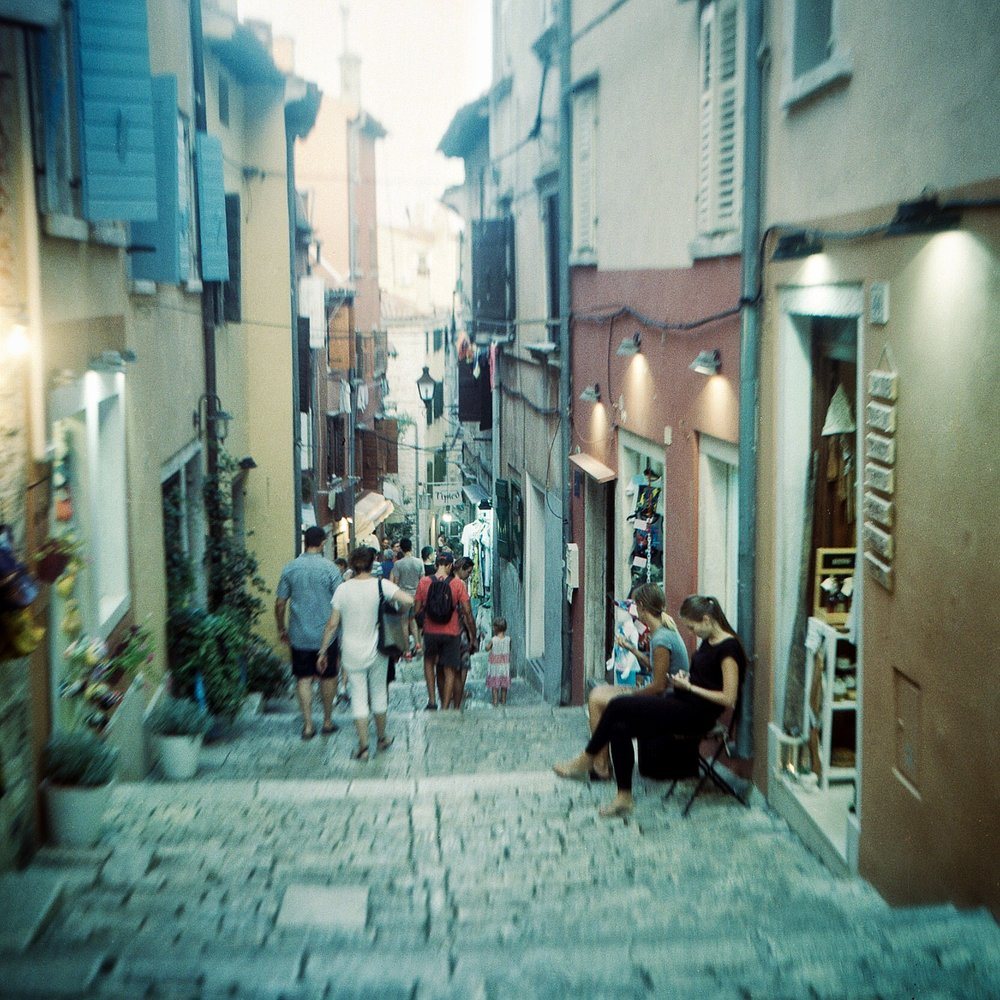 Street scene at dusk in Rovinj, Croatia.