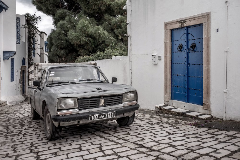 Africa's finest - a battered old Peugeot struggling up a hill in Sidi Bou Said.