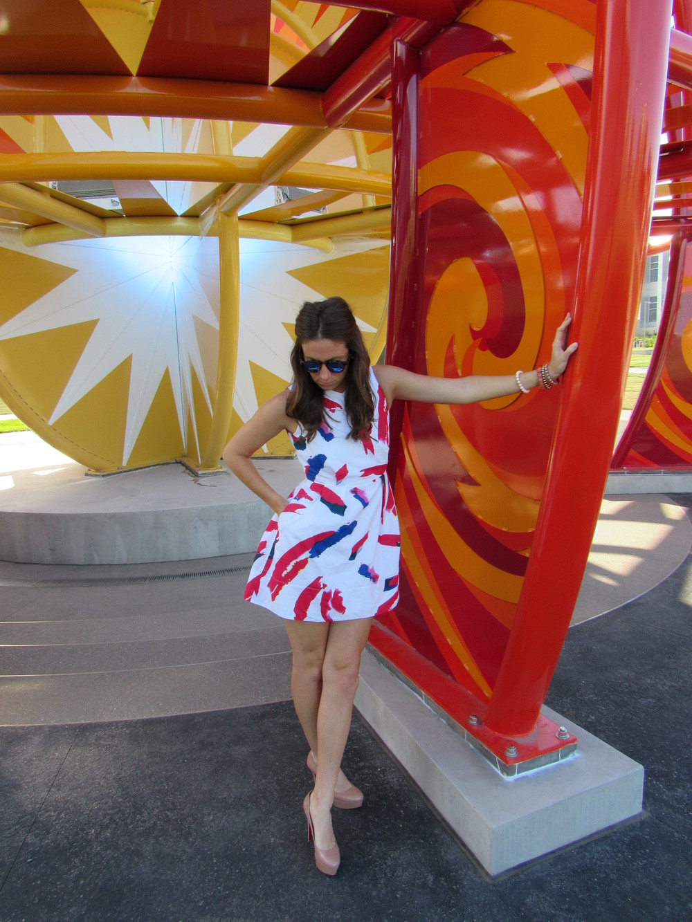 Dress: gap, similar  here . Shoes: Christian Louboutin, found  here . Sunnies: Illesteva, found  here .