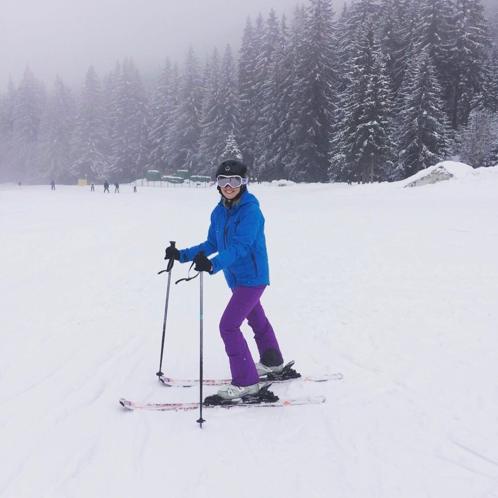 My sister getting to grips with her skis