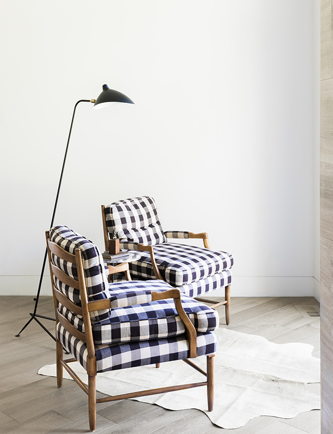 SENTIMENTAL VALUE - The client inherited this pair of chairs and had them recovered in a playful check pattern; they now feel right at home in their sleek new surroundings.