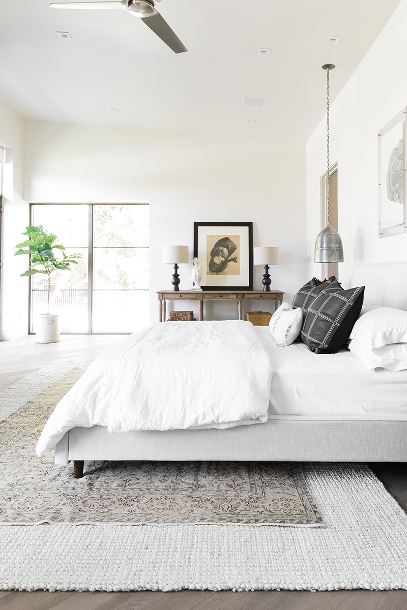 MODERN BALANCE - While preserving the clean, modern vibe, we added some of the client's favorite artwork from their personal collection and neutral but bold accessories to complete this serene and light-filled space.