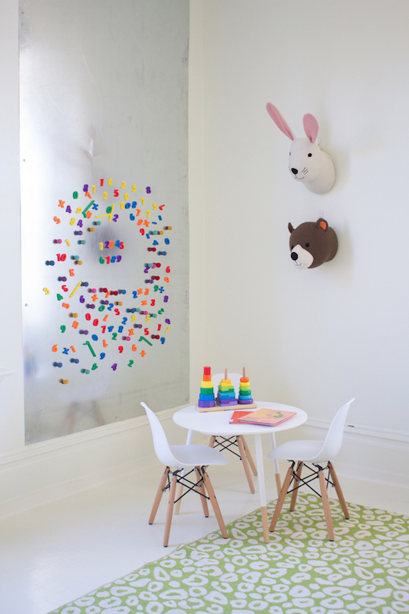 BOOK SMART - A historic space awash in white (with a healthy dose of whimsy) is a perfect backdrop for reading and play.