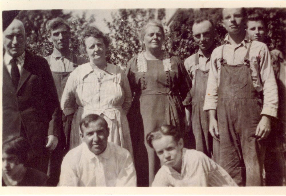 Detail, ca. 1920. Standing (left to right):   Maurice B. Wolfe  , Frank and Mary Carraher, Sarah McAndrews Wolfe,   Ray Wolfe  ,   Phil Wolfe  ,   Melvin Wolfe