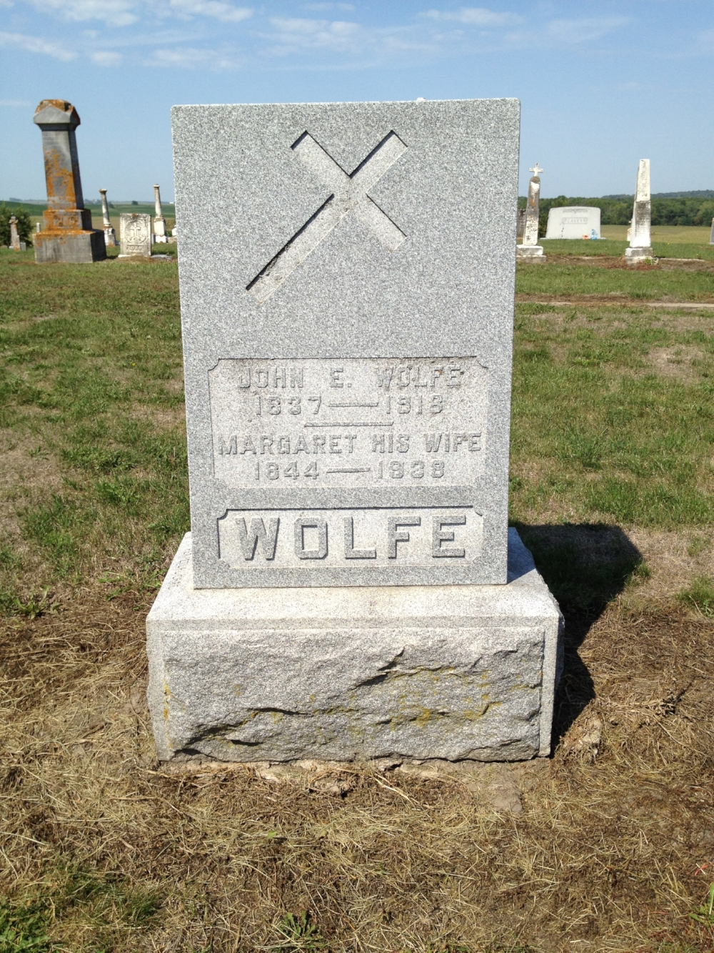 Gravestone of John E. Wolfe, Saint James Cemetery, Toronto, Iowa
