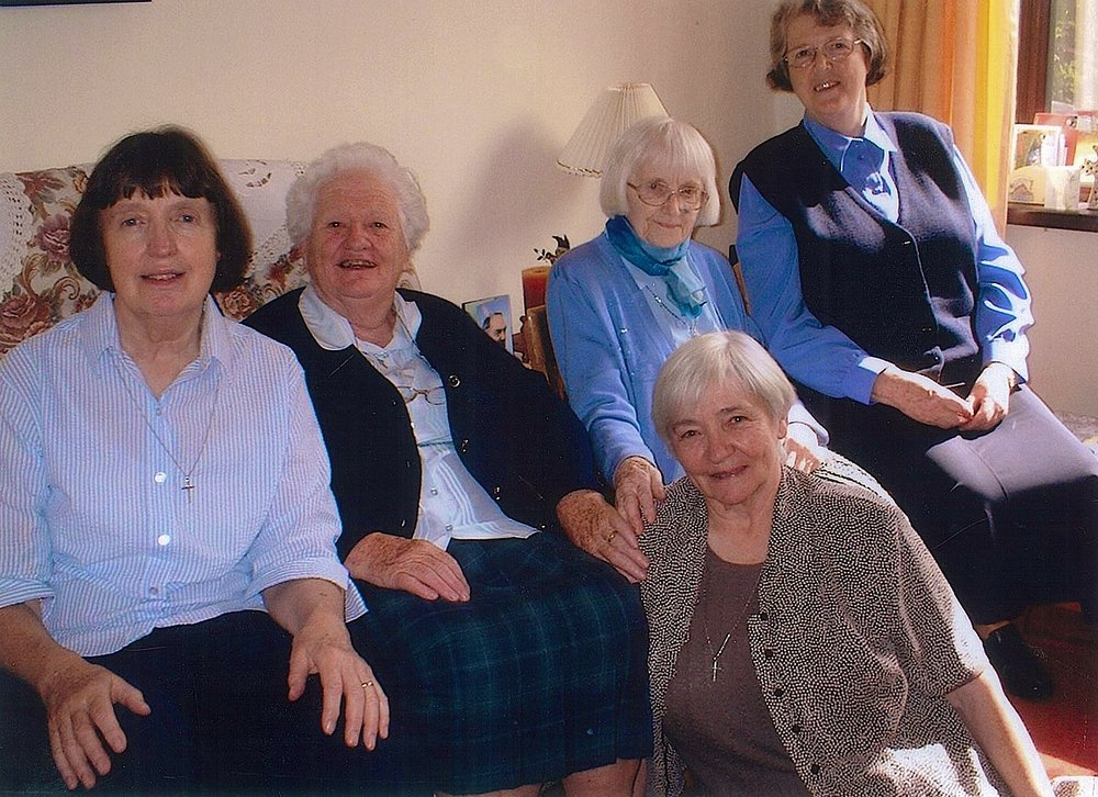 Sister Ide Wolfe (third from the left, in back) sits with her community of sisters in Belfast (  Sisters of Saint Louis  )