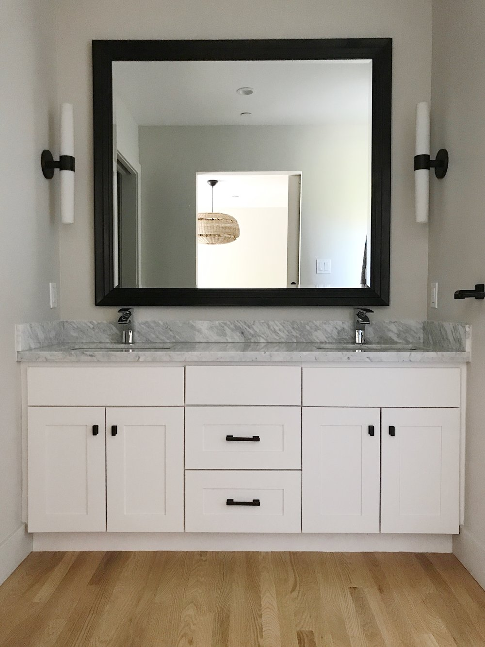 Blandsville - someday the sconces, mirror and faucets will all go but for now....