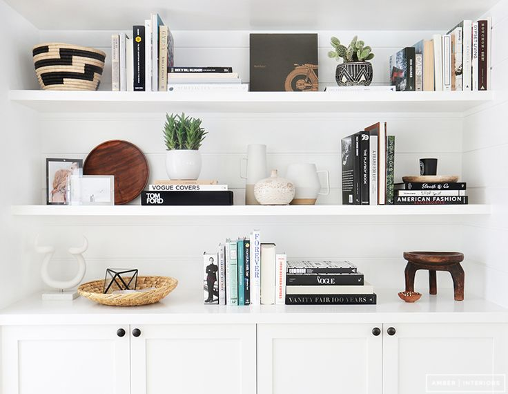 Brilliantly eclectic and perfectly balanced shelves by  Amber Lewis