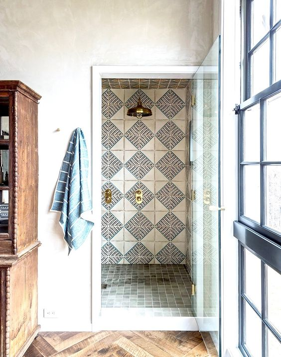 Stunning bathroom design with hand painted terracotta by  Jennifer Bunsa