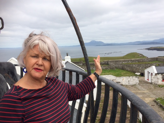 Roie McCann, showing off the stunning views from atop the lighthouse tower.