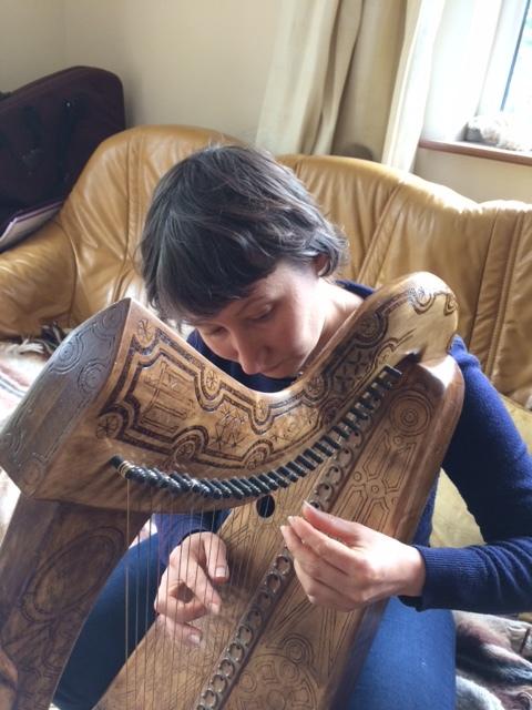 Natalie Surina playing an ancient Irish harp.