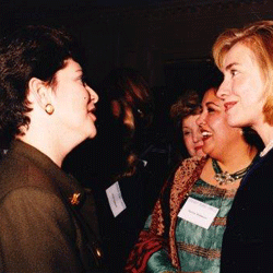 Jo Deutsch speaks with then First Lady Hillary Clinton at a political event.