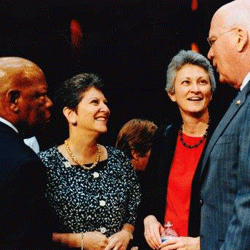 Jo Deutsch speaks with Senator Patrick Leahy (D-VT), Congressman John Lewis (D-GA), and Susan Murray at the 2011 U.S. Senate hearing to assess the impact of the Defense of Marriage Act on families.