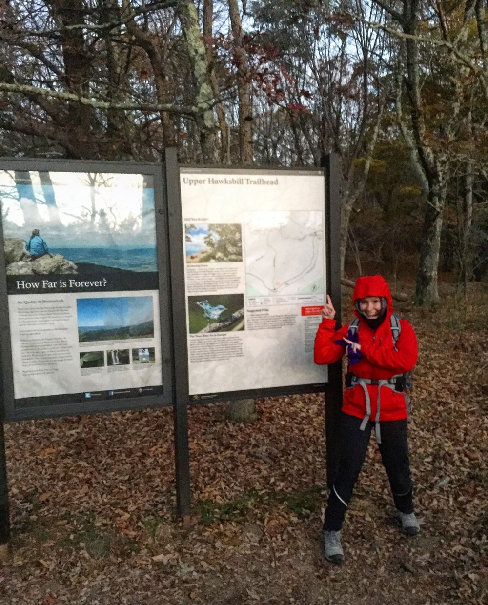 Hey, that's me in front of the trail sign bundled in a ton of layers because it was so cold!