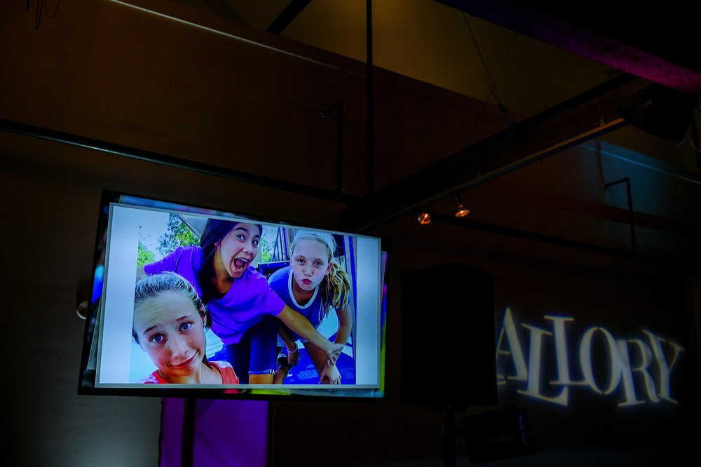 TV Monitor displaying images at mallory's bat mitzvah.jpg