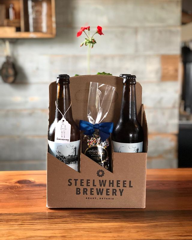 "Available just in time for Mother's Day, we have ""The Bomb Beer Mom"" gift pack!  This limited supply gift pack includes 4 beers of your choice, dark chocolate treats from @le_chocolat_du_savoie and a cute little geranium. 🌱 Sure to brighten the heart any mom!(Exclusive to this offer one bottle can be a Mango Sour!) Get yours while supplies last!"