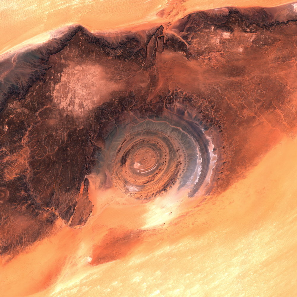 The eye of the Sahara is a serious of concentric circles carved in the rock and offering a pleasing contrasts with the surrounding yellow/orange sands of the Sahara desert.