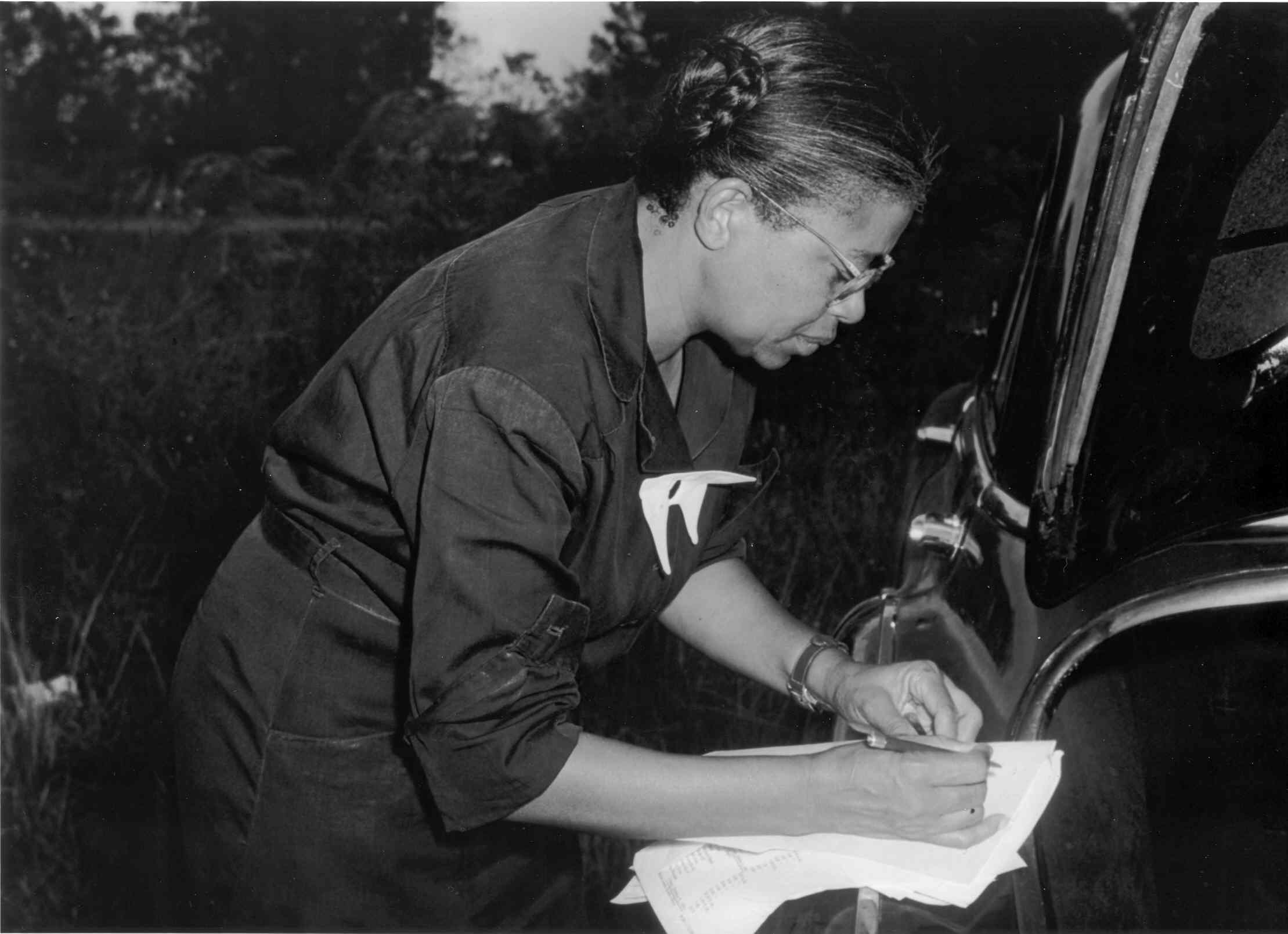 Nurse Eunice Rivers filling out paper work  Image courtesy of National Archives, Atlanta, GA