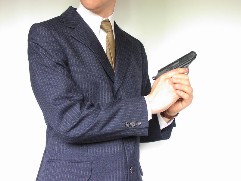 1737-man-in-a-suit-with-a-small-pistol-pv.jpg