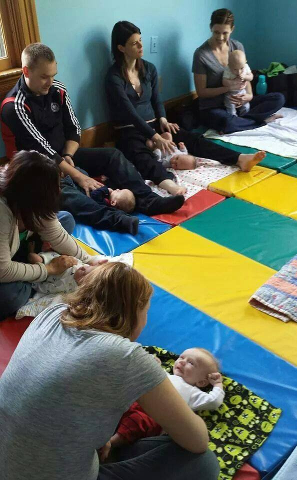 Parents gather to learn more about tummy time with their babies.