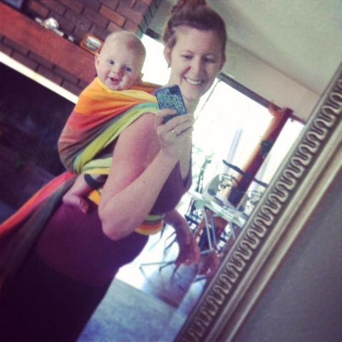 Portland mom and baby in babywearing back carry