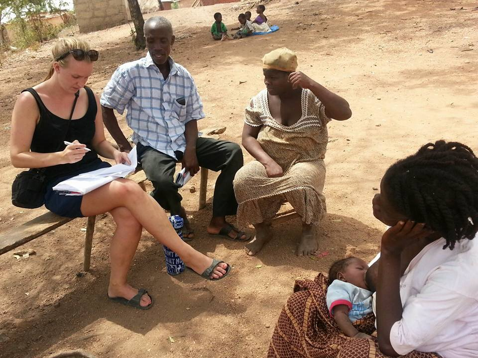 Volunteers collecting data on malnourished children in a small African village