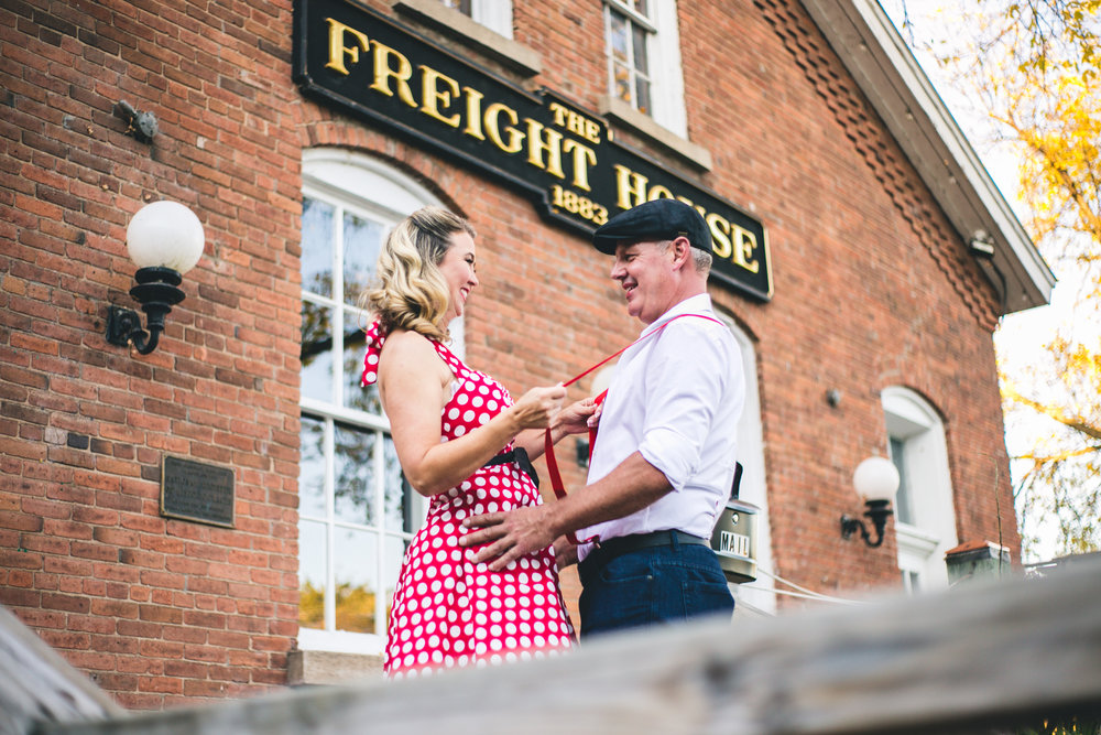 Man and Woman flirt in front of Freight House in Stillwater