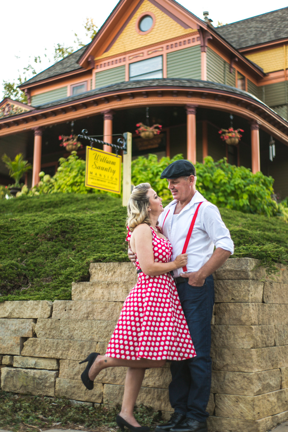 Couple poses in front of The William Sauntry Mansion in Stillwater