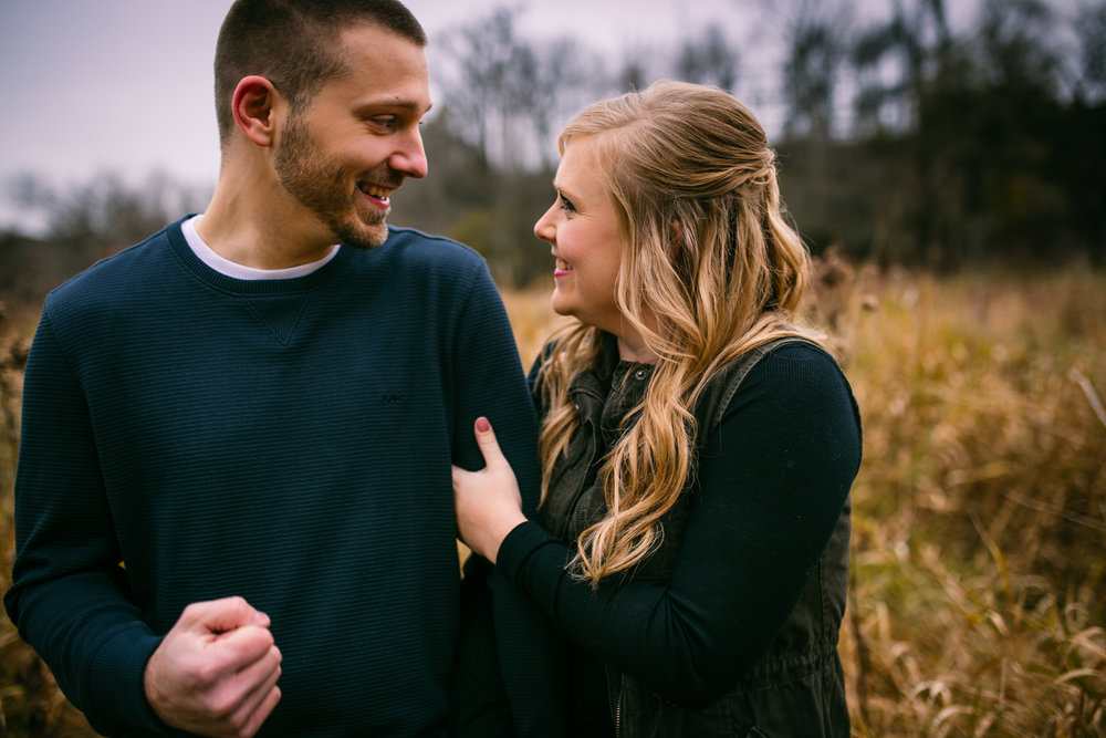 engaged couple smiling and laughing in River Falls WI