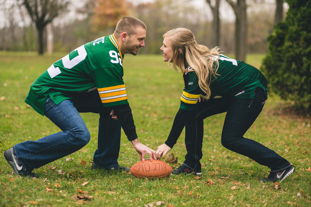 couple wearing Green Bay Packer jerseys for engagement photos