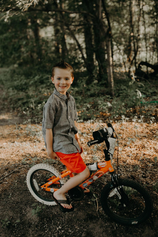 boy on a bike in river falls wi