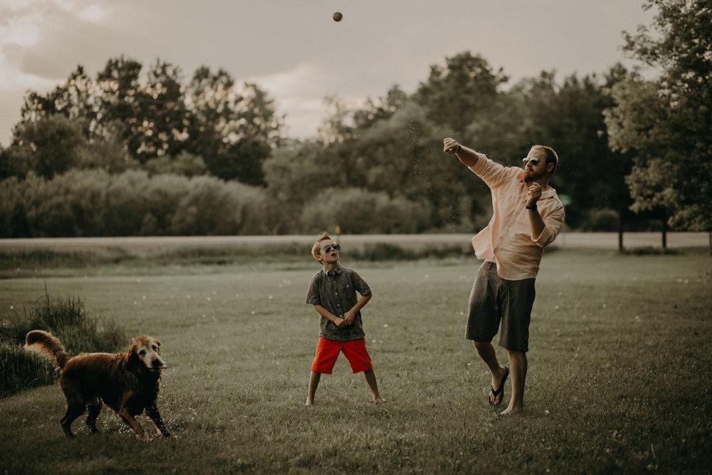 River Falls dad throwing a ball to his golden retriever pup