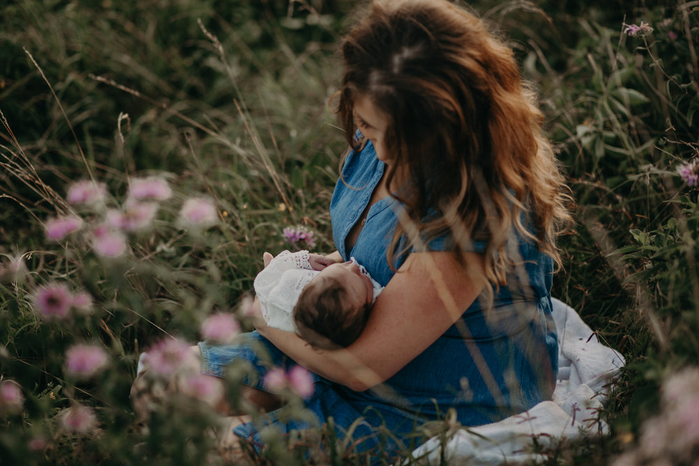 Newborn baby girl and mommy from River Falls WI in field of flowers