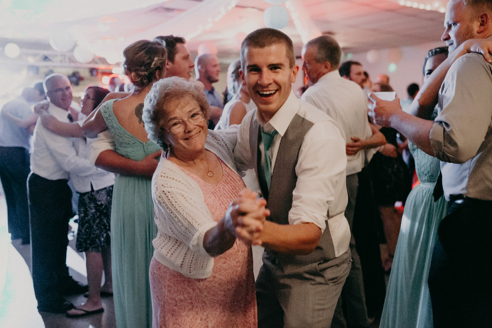 Travis Stargardt dances with family at wedding reception