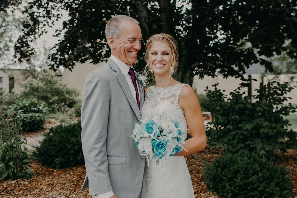 Tiffany Stargardt and her father pose for pictures at wedding by Andrea Wagner Photography