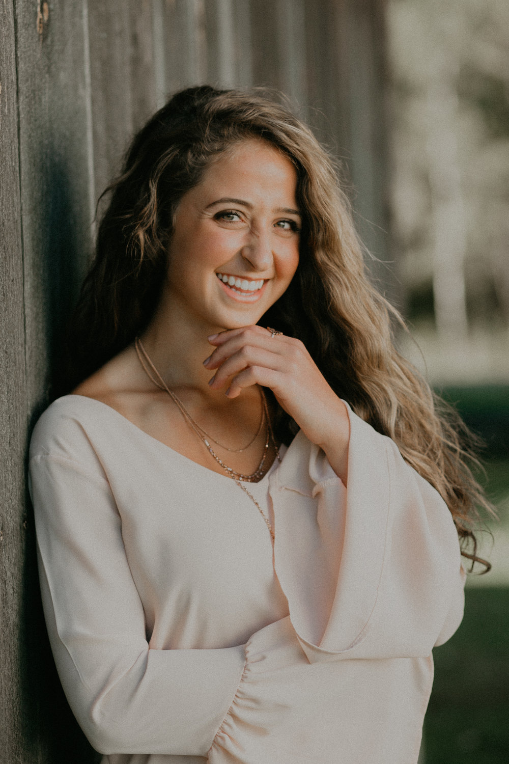 Dara Stichert from Chili WI poses at Stichert Farms for her senior pictures