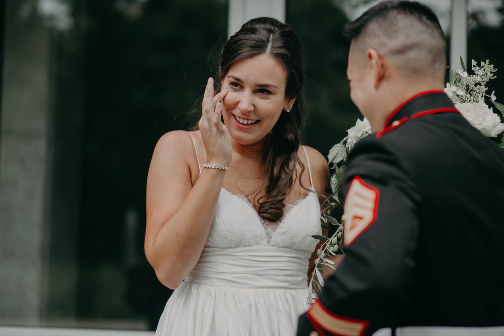 Military groom sees his bride for the first time at Hotel Landing