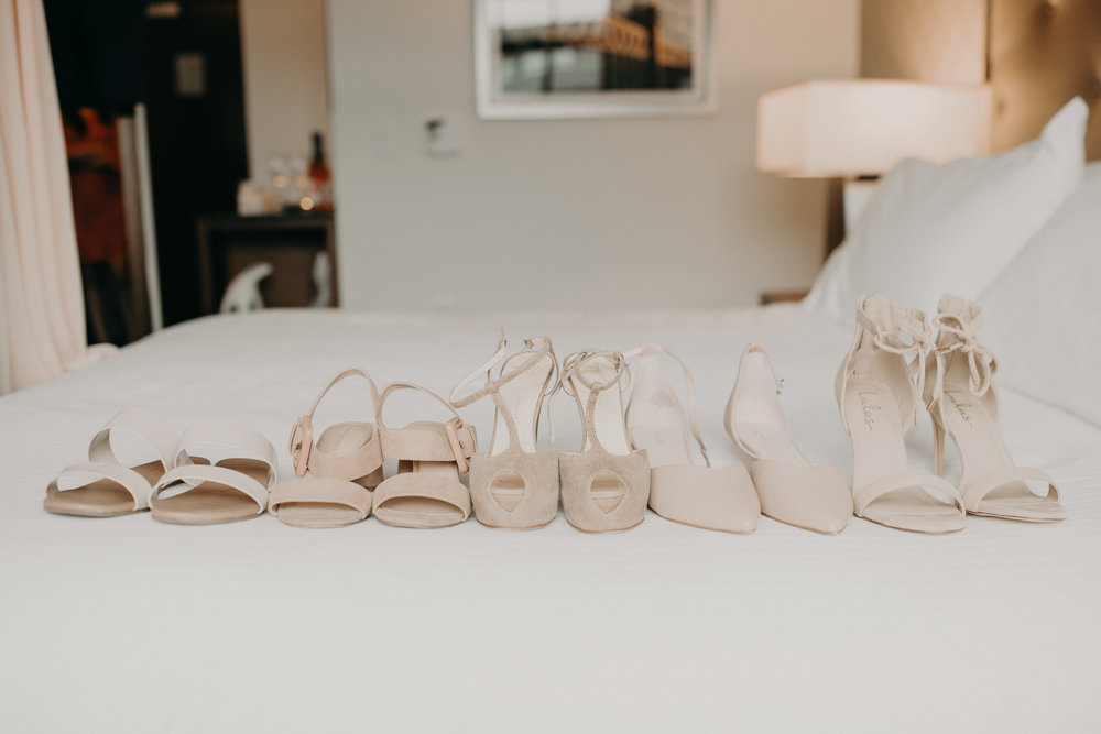 wedding shoes on the hotel bed in Wayzata MN Hotel Landing